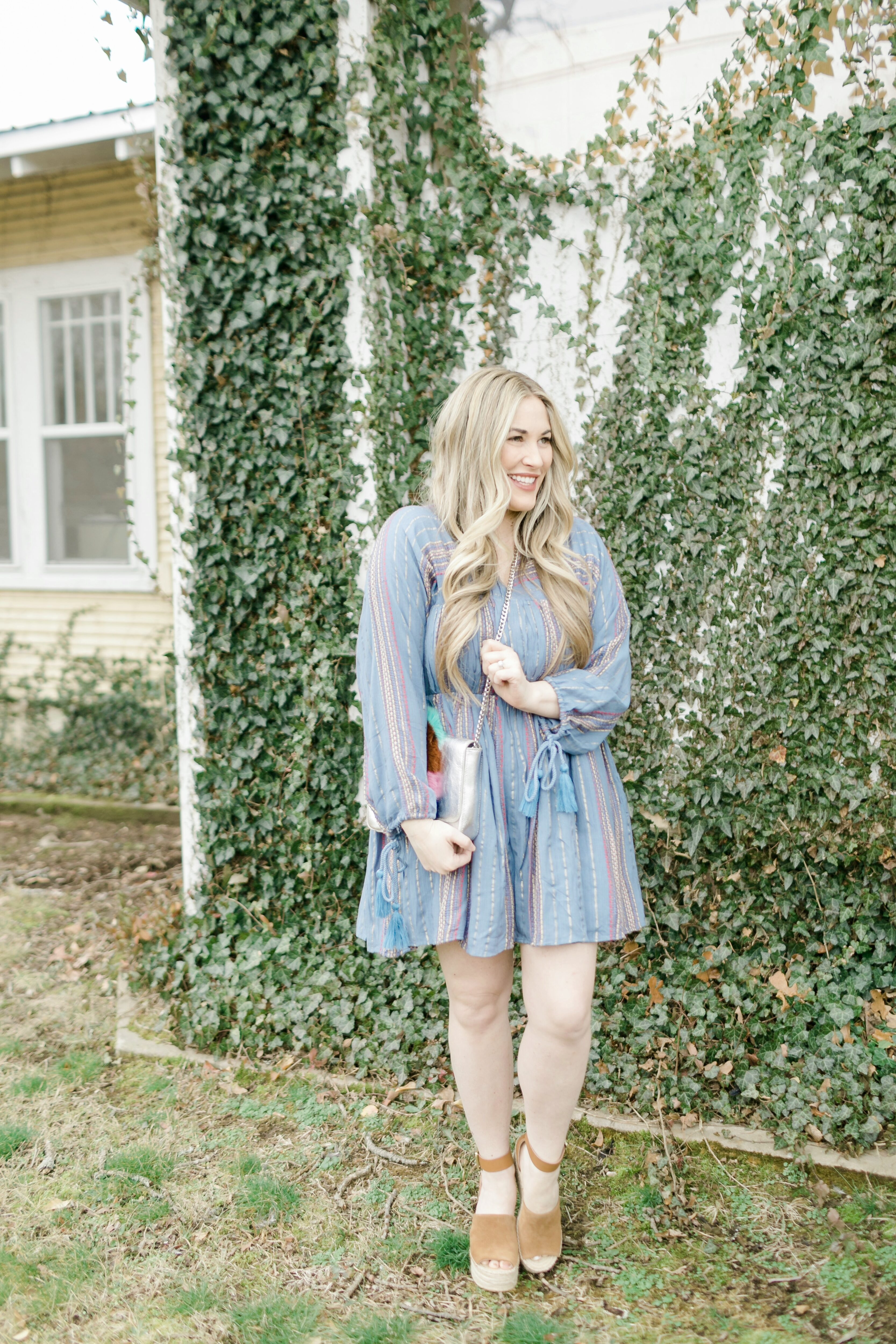Cute spring dresses featured by top Memphis fashion blogger, Walking in Memphis in High Heels: image of a woman wearing an ASOS denim striped dress