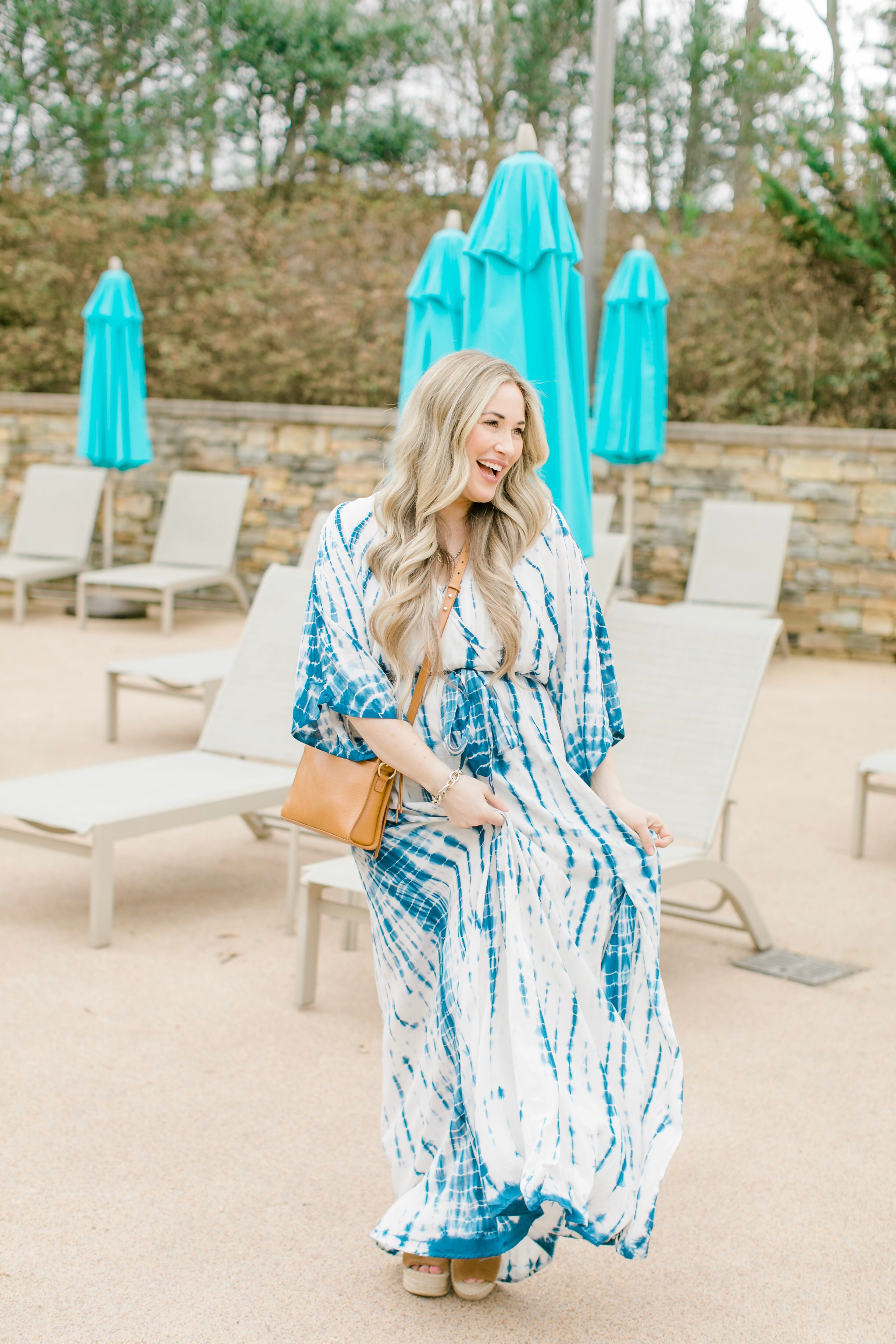 Cute spring sandals featured by top Memphis fashion blogger, Walking in Memphis in High Heels: image of a woman wearing Marc Fisher wedge espadrilles.