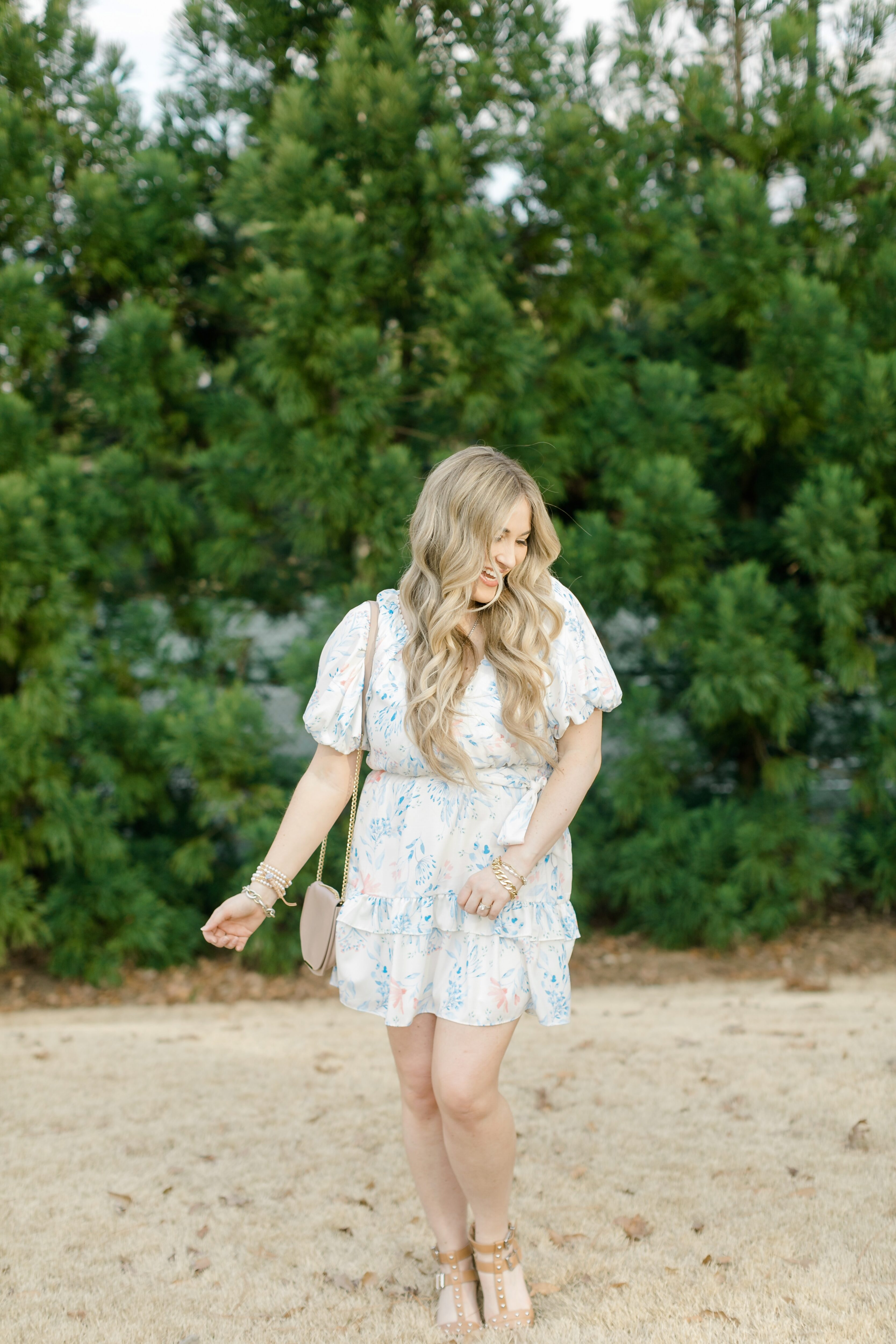 Cute Easter dresses for Women featured by top Memphis fashion blogger, Walking in Memphis in High Heels: image of a woman wearing a Red Dress Boutique floral dress.