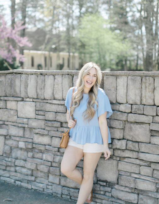 Cute spring shorts for women styled by top Memphis fashion blogger, Walking in Memphis in High Heels: image of a woman wearing Altar'd State shorts