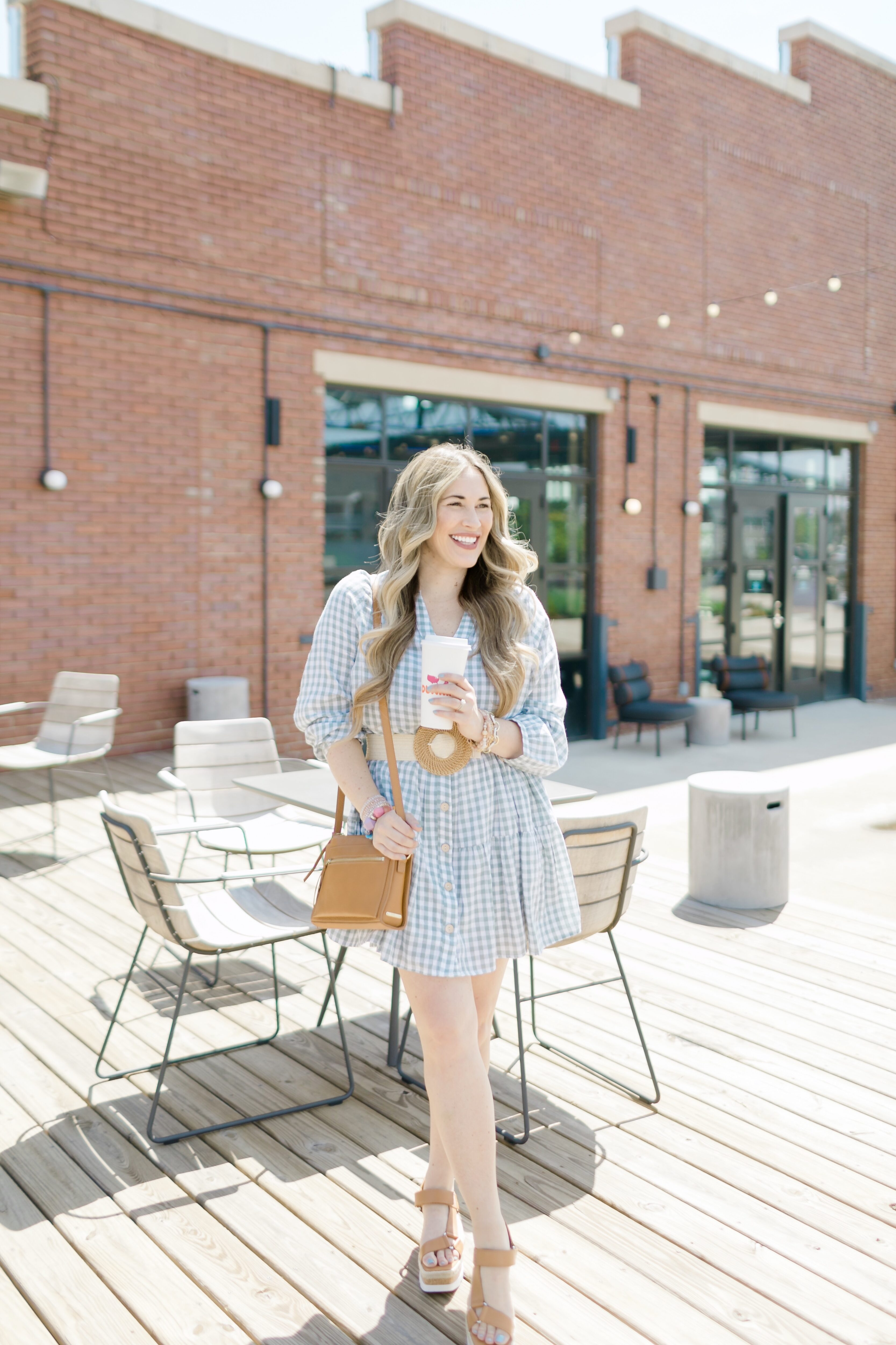 Cute Spring look styled by top Memphis fashion blogger, Walking in Memphis in High Heels: image of a woman wearing a Red Dress Boutique Gingham Dress.