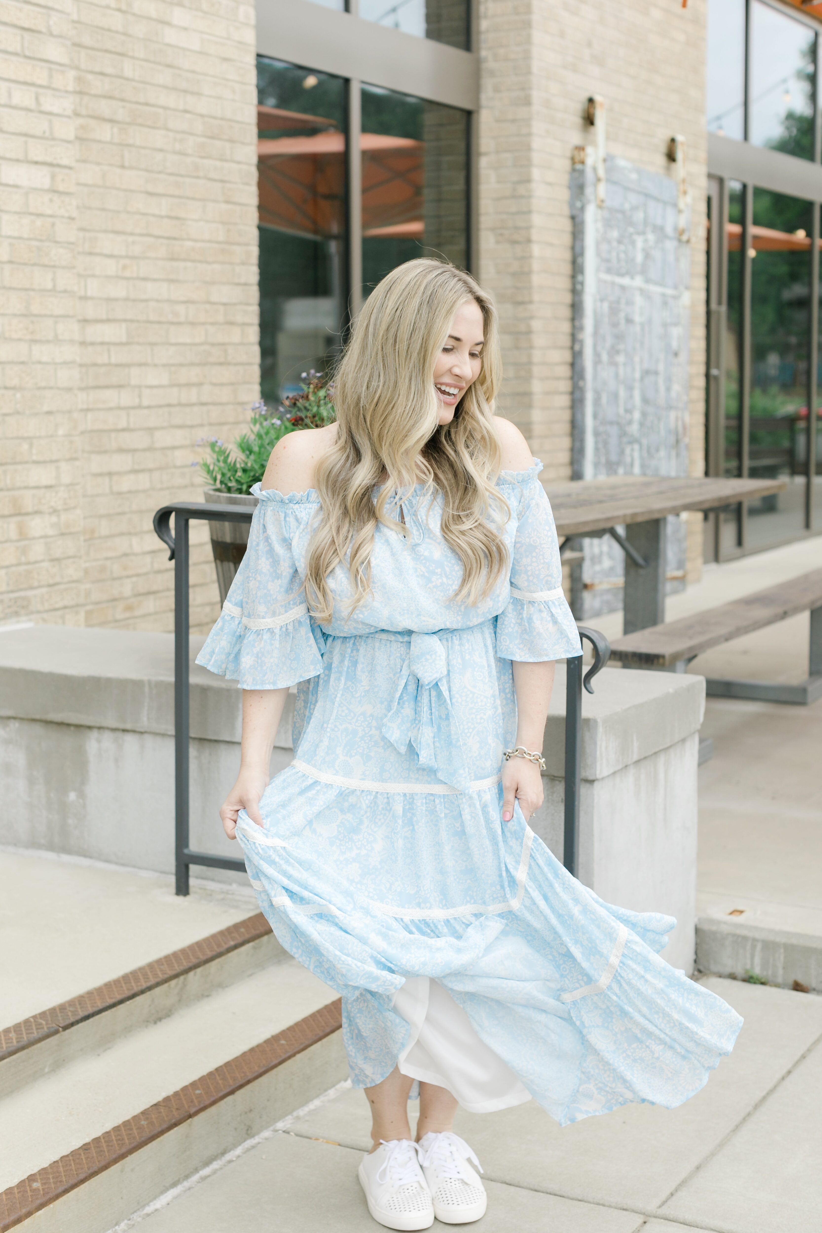 Midi and Maxi dresses for summer featured by top Memphis fashion blogger, Walking in Memphis in High Heels: image of a woman wearing a Pink Blush blue maxi floral dress.