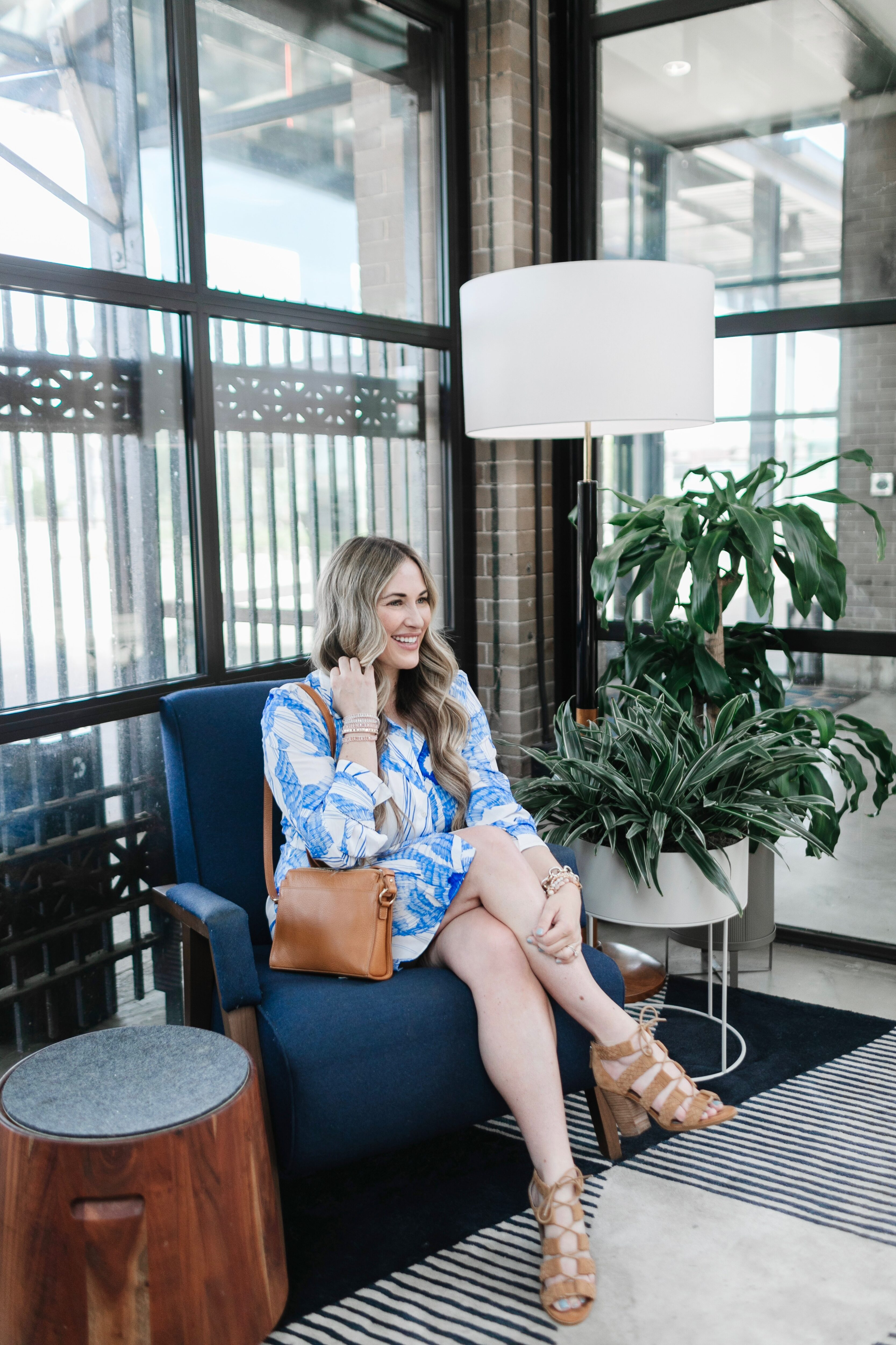 Cute spring dresses and skirts featured by top Memphis fashion blogger, Walking in Memphis in High Heels: image of a woman wearing a Robert Graham shirt dress.