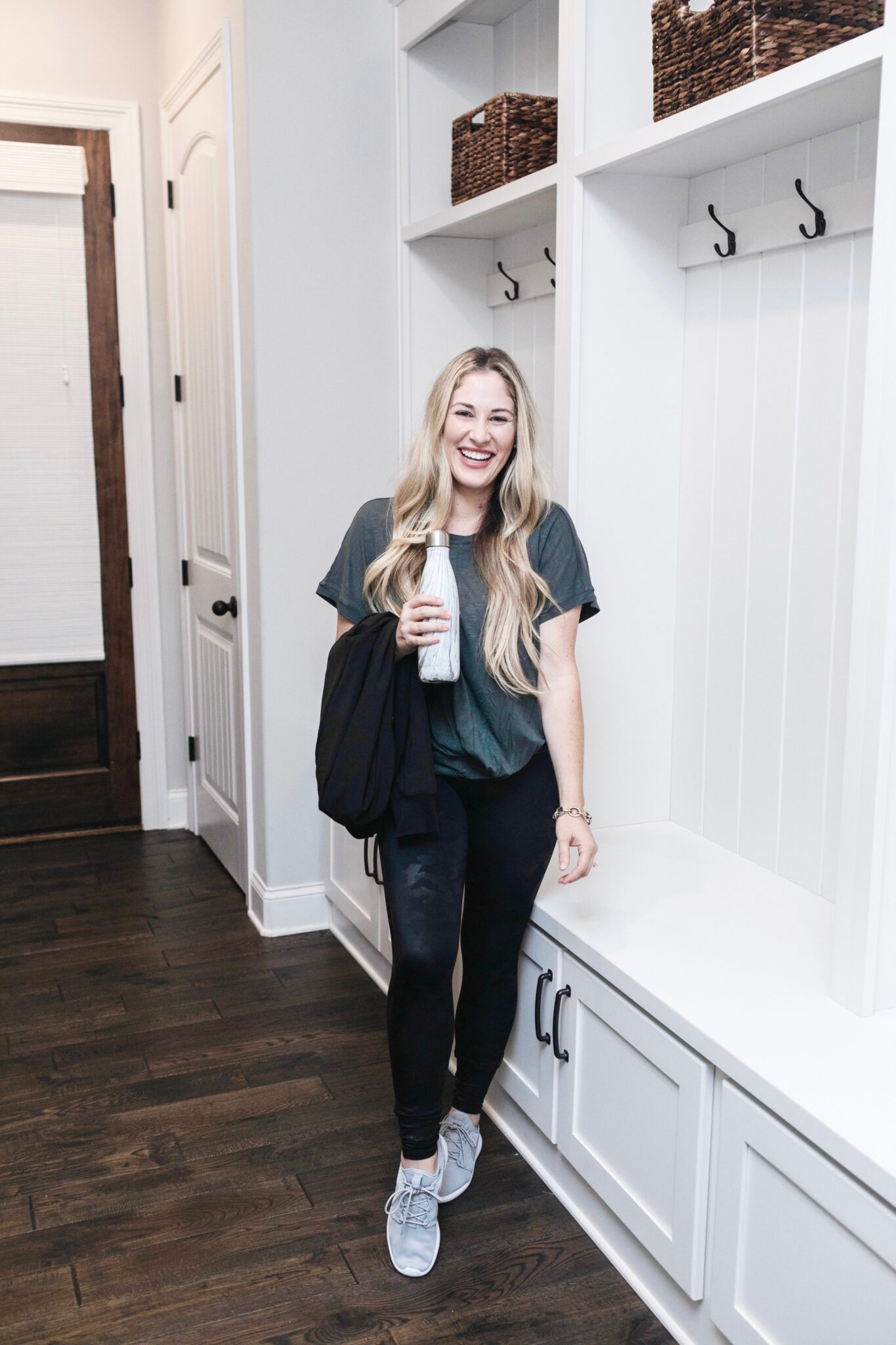 Athleisurewear for moms featured by top US fitness blogger, Walking in Memphis in High Heels: image of a woman wearing A Soma tunic, Spanx faux leather camouflage leggings, and Adidas Swift Run X Sneakers
