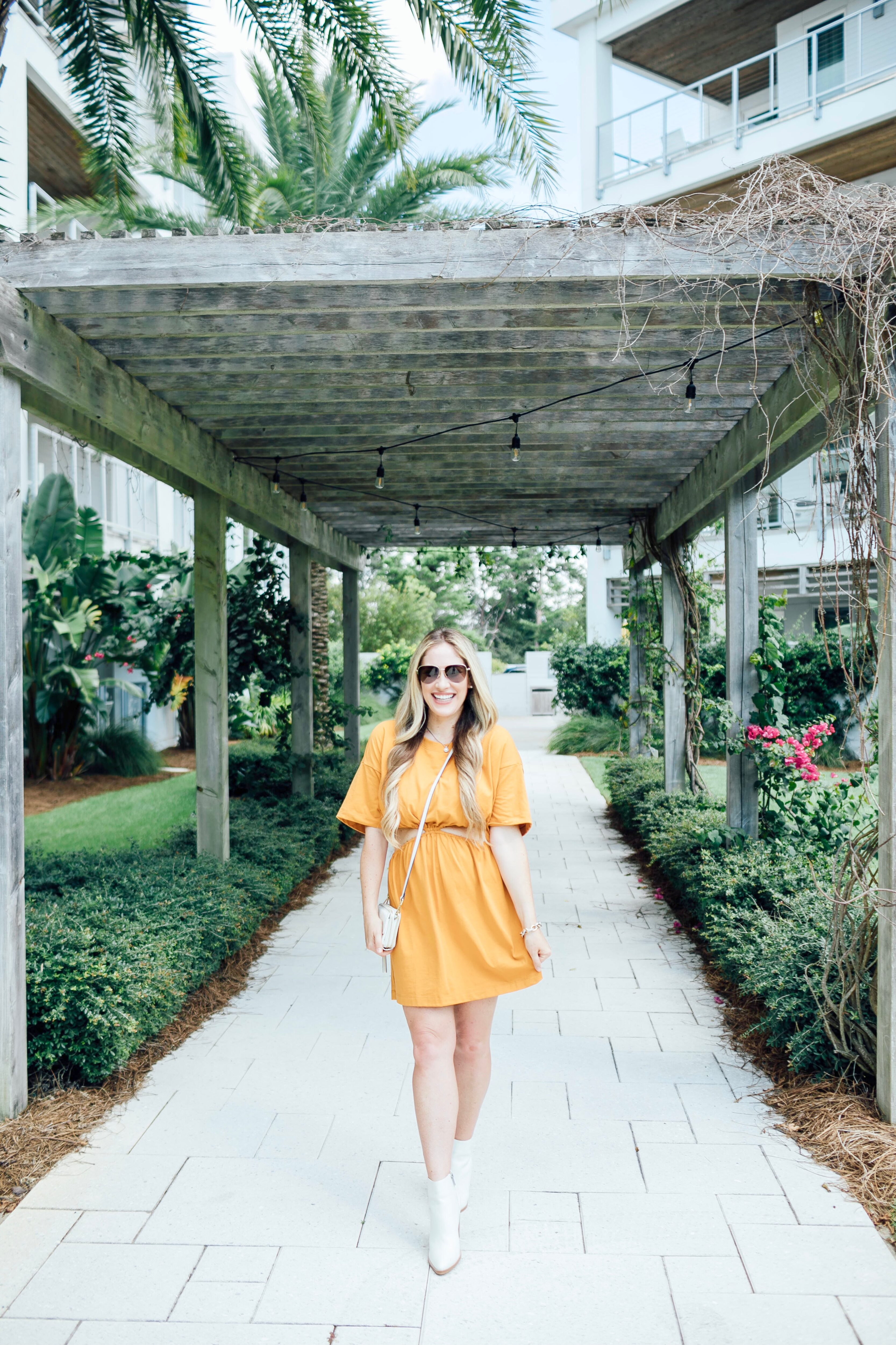 Summer to fall look featured by top US mom fashion blogger, Walking in Memphis in High Heels: image of a woman wearing a yellow Free People dress and Marc Fisher white booties.