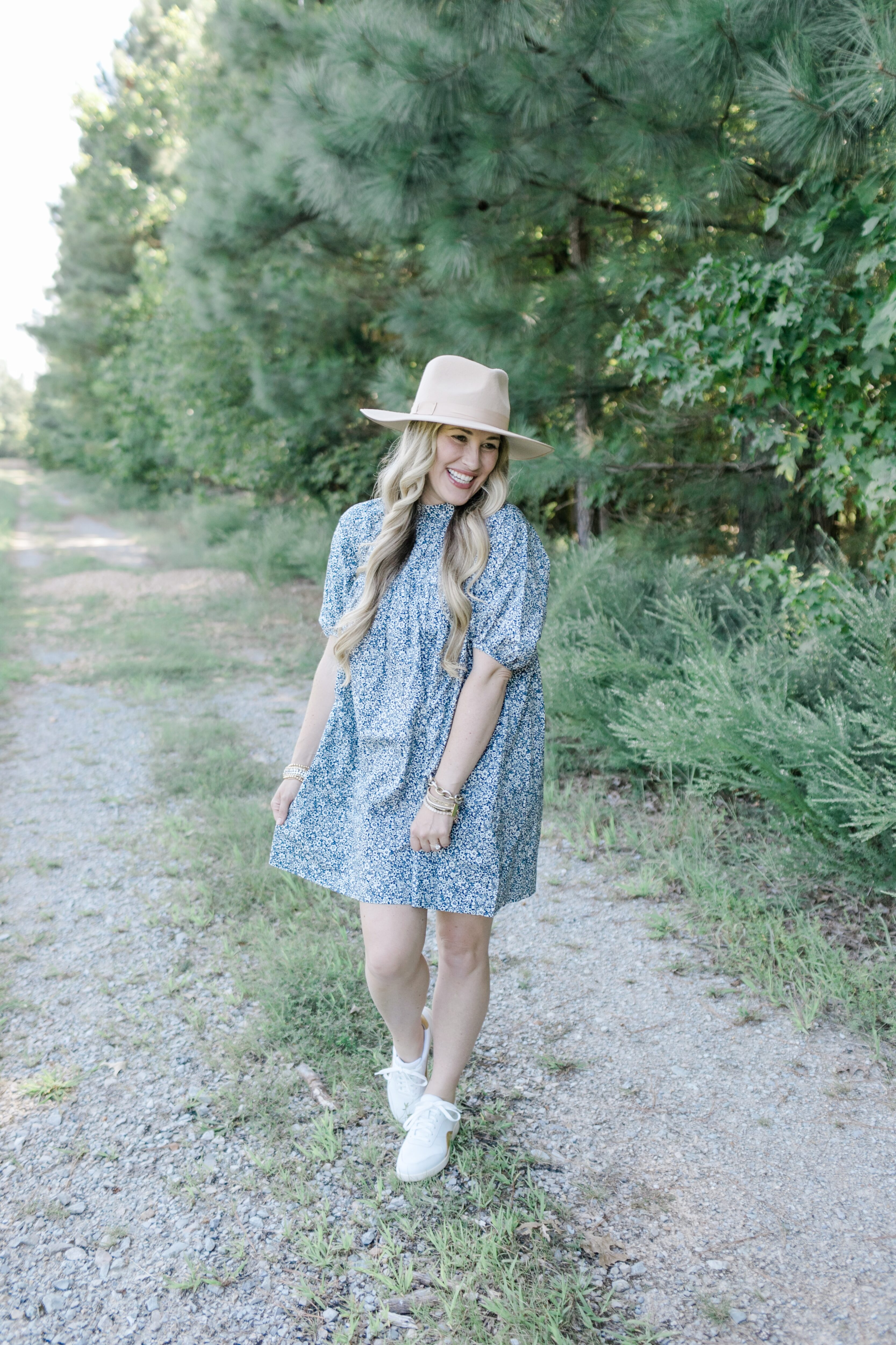 Fall floral dress styled by top US mom fashion blogger, Walking in Memphis in High Heels: image of a woman wearing an Everlane navy blue floral mini dress.